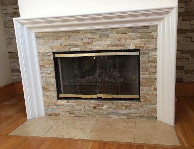 Stone veneer fireplace 1