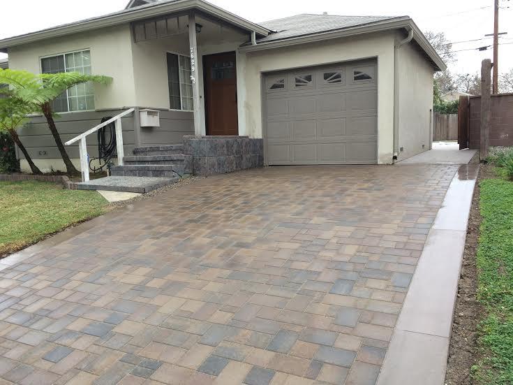 Paver driveway with a concrete ribon